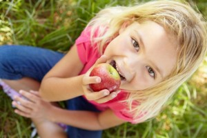 little-girl-eating-an-apple
